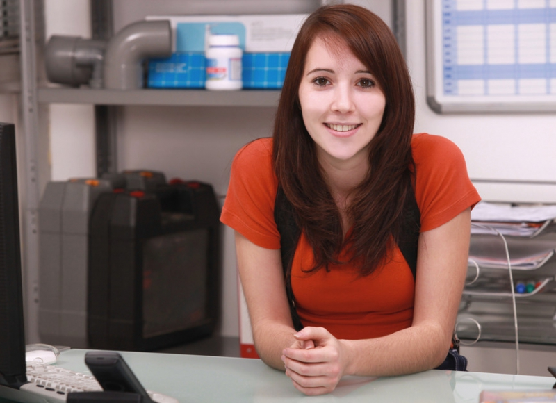 Young woman working in the office of a plumbing firm